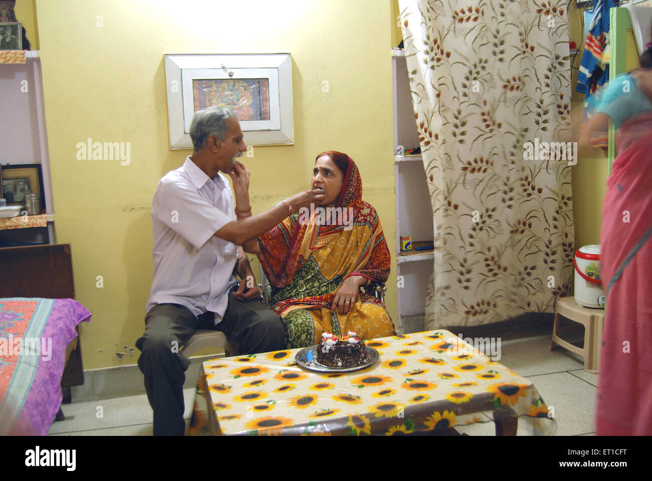 husband and wife feeding birthday cake to each other in home mr on free birthday cake for husband