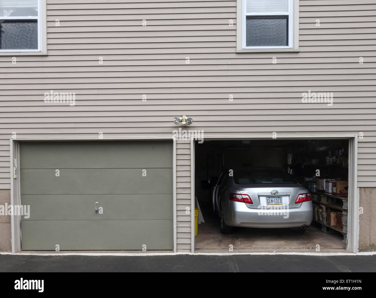 Garage Doors Inside House : Open garage door with car parked inside american style