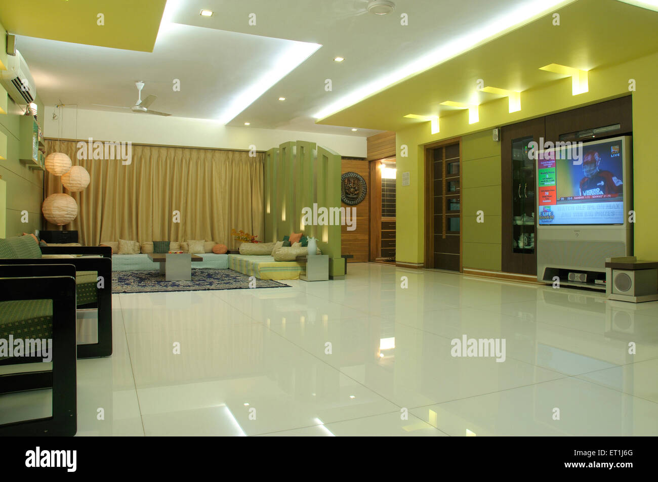 Living Room With Sitting Arrangement And Artificial Light
