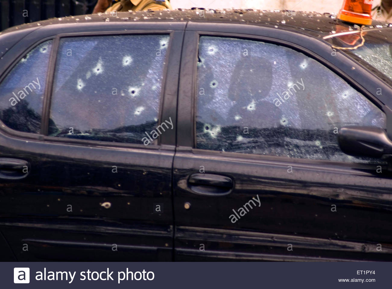 bullet marks holes of ak 47 machine gun black car terrorist attack stock photo royalty free. Black Bedroom Furniture Sets. Home Design Ideas