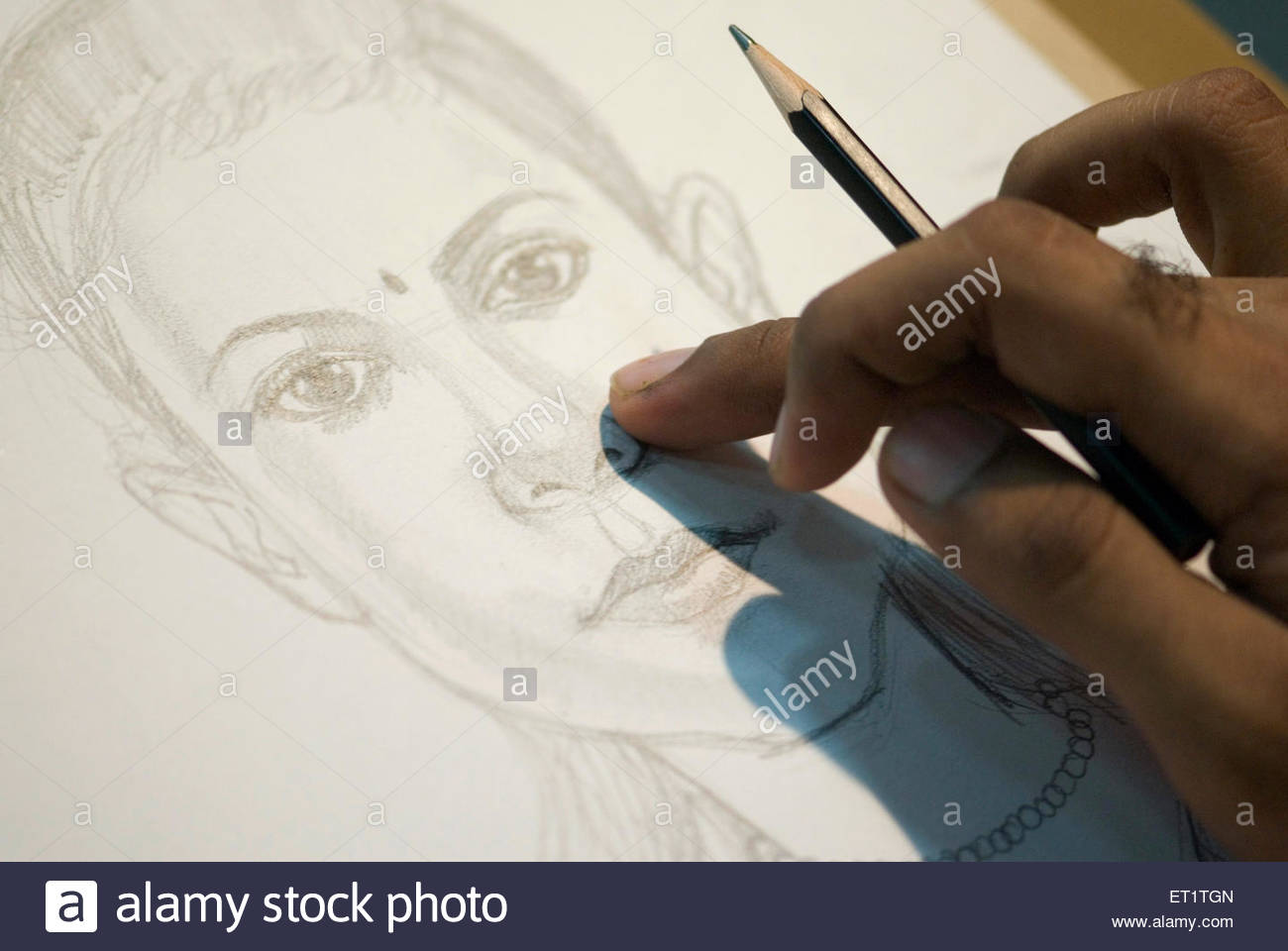 An artist making a girl caricature sketch drawing with pencil on ...
