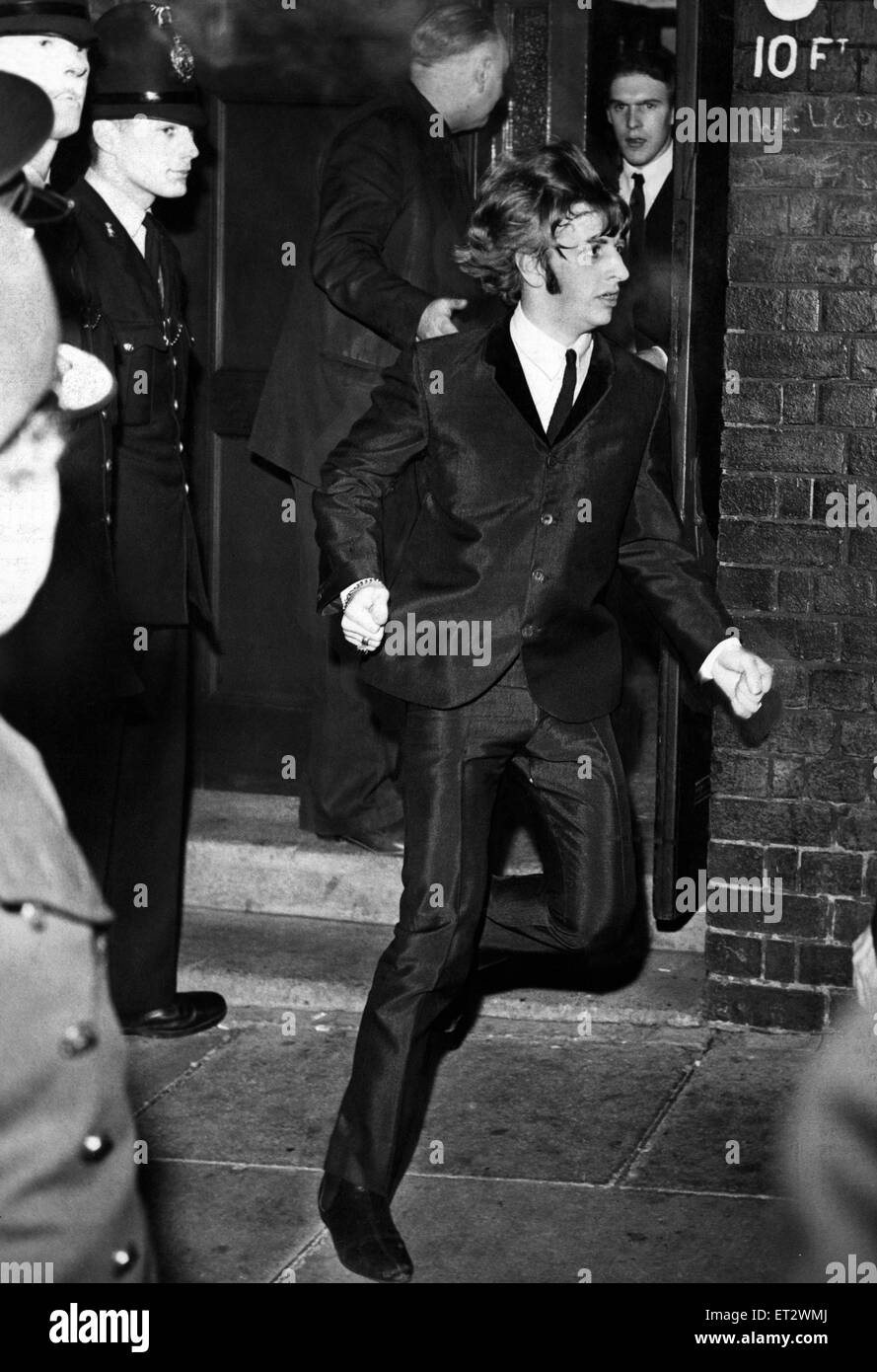 Beatles Drummer Ringo Starr Bolts From A Side Exit To A Waiting