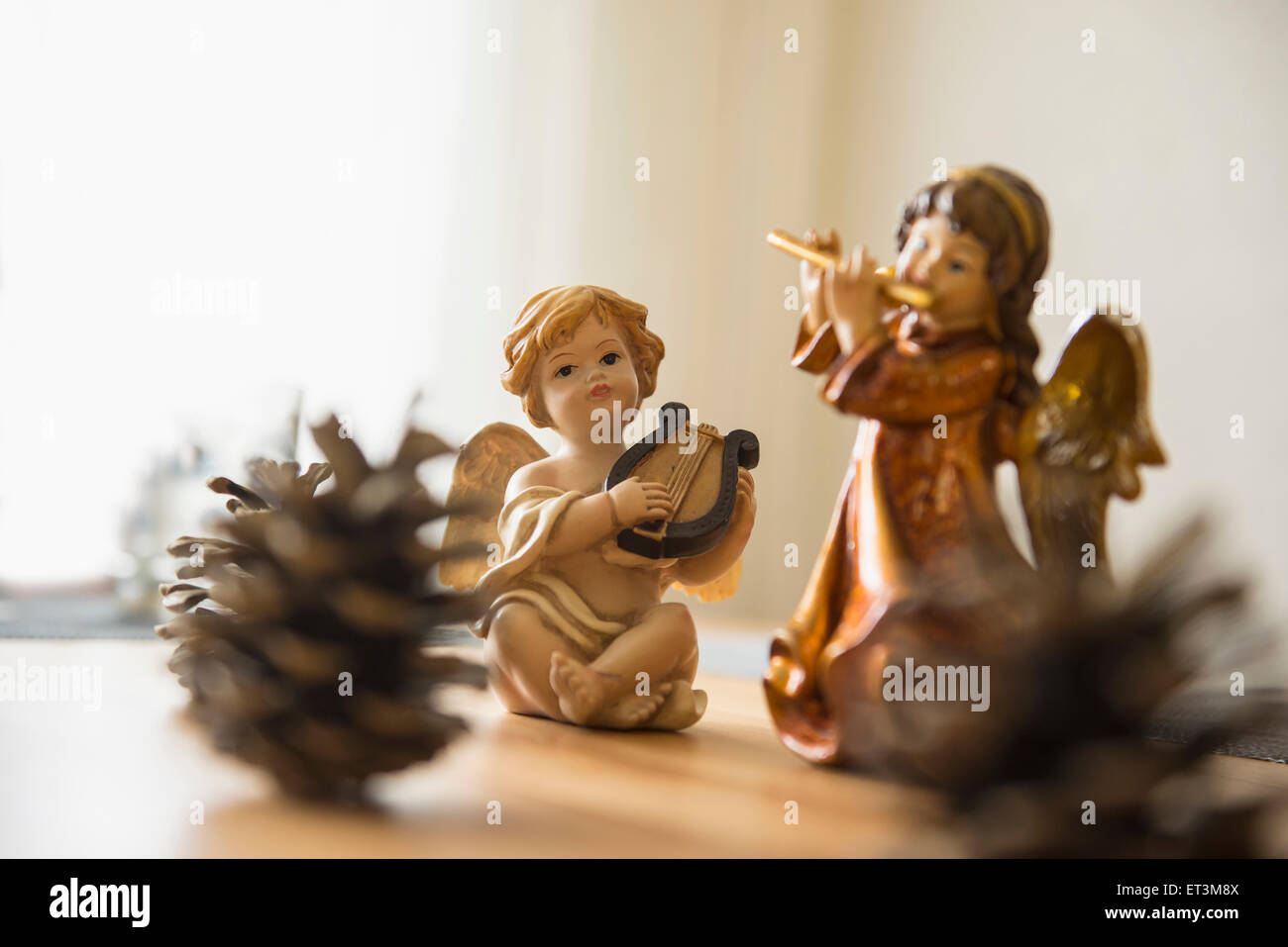 Decorative Christmas angel figurines with musical instruments and ...