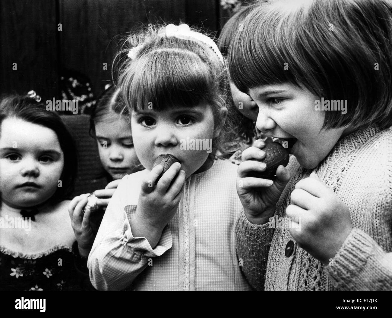 Children eating chocolate easter eggs, 27th March 1975 Stock Photo ...