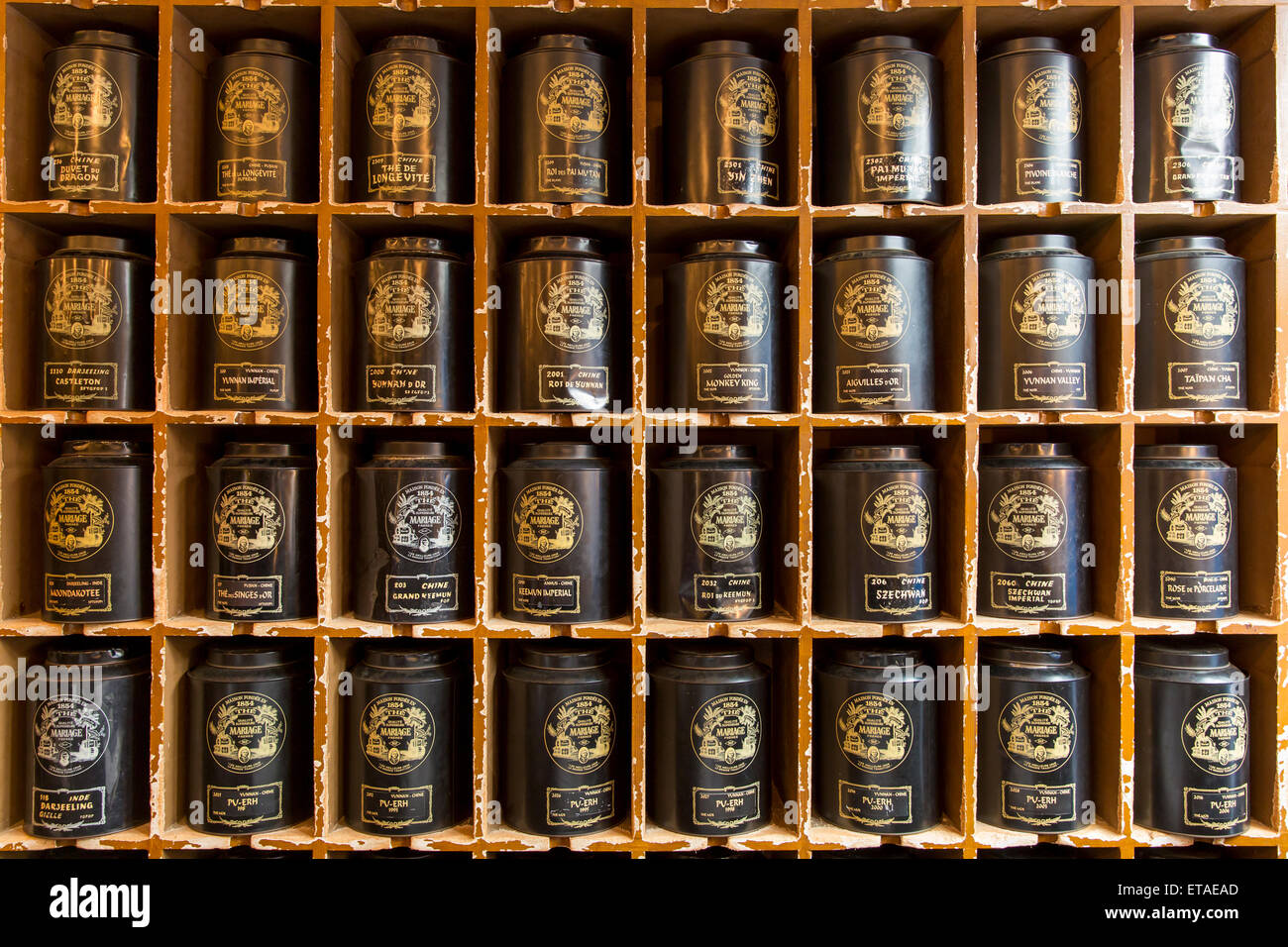 canisters of tea wall display at world famous mariage freres salon de the marais paris france - Mariages Freres