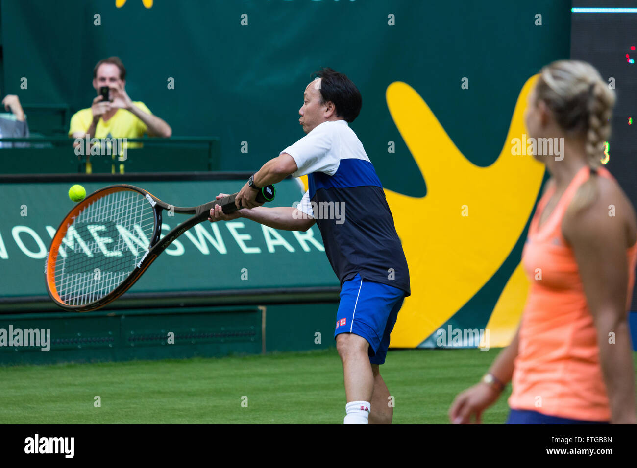 Michael Chang with an oversize racquet during an exhibition match
