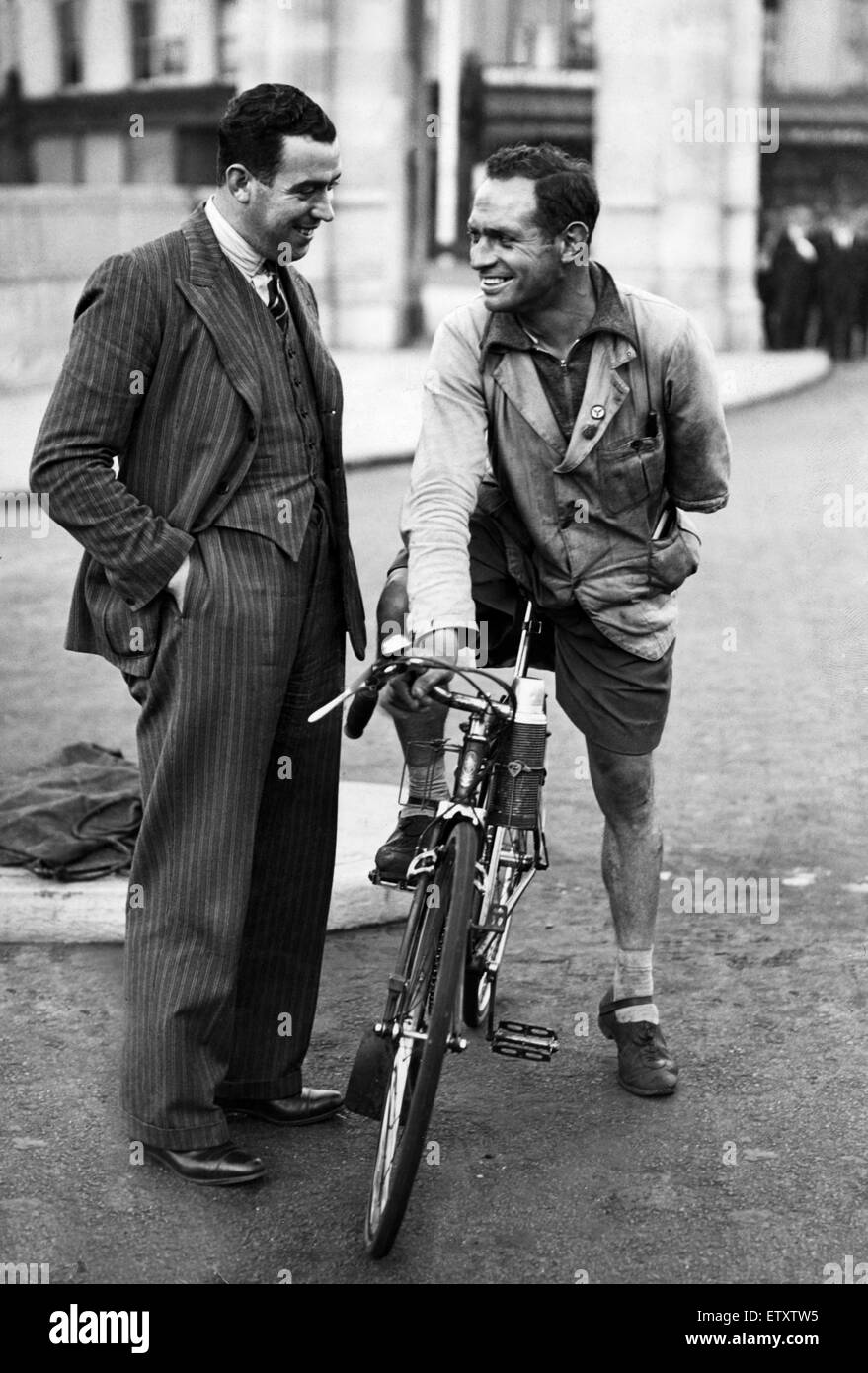 Everton footballer Dixie Dean talking with a cyclist in Liverpool