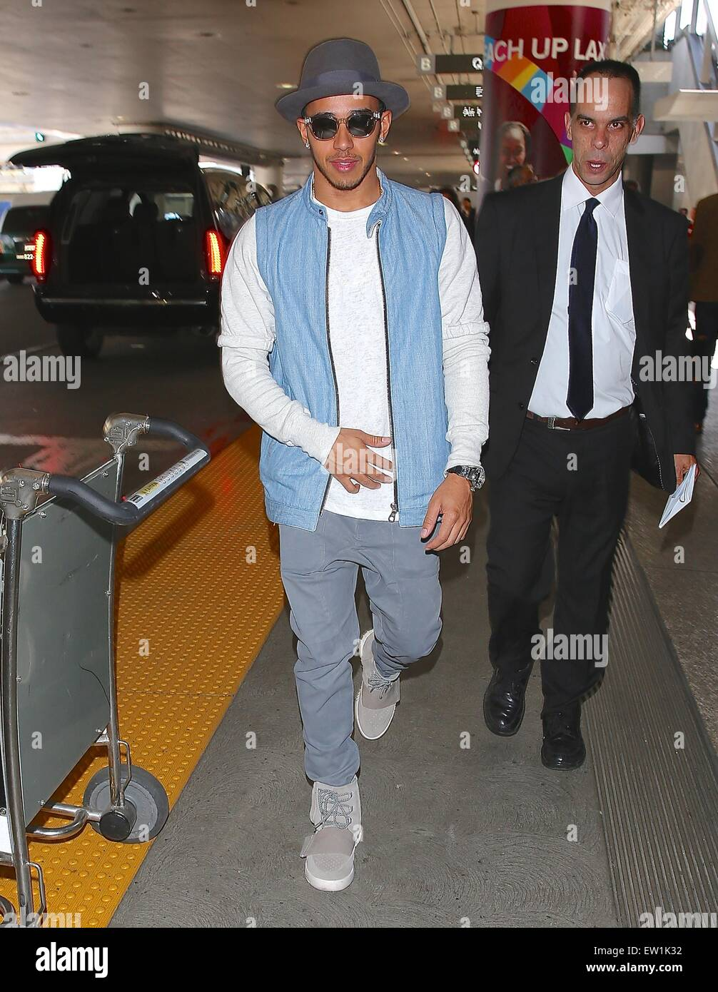 05e4d052 ... lewis hamilton wearing a pair of kanye west x adidas yeezy 750 boost  arrives at los