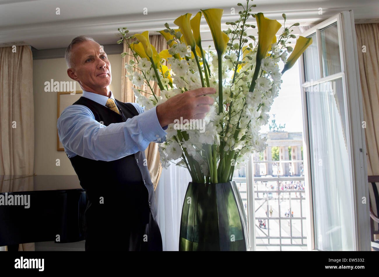 mario weidner florist at hotel adlon straightens a bouquet of yellow calla lilies and - Yellow Hotel 2015