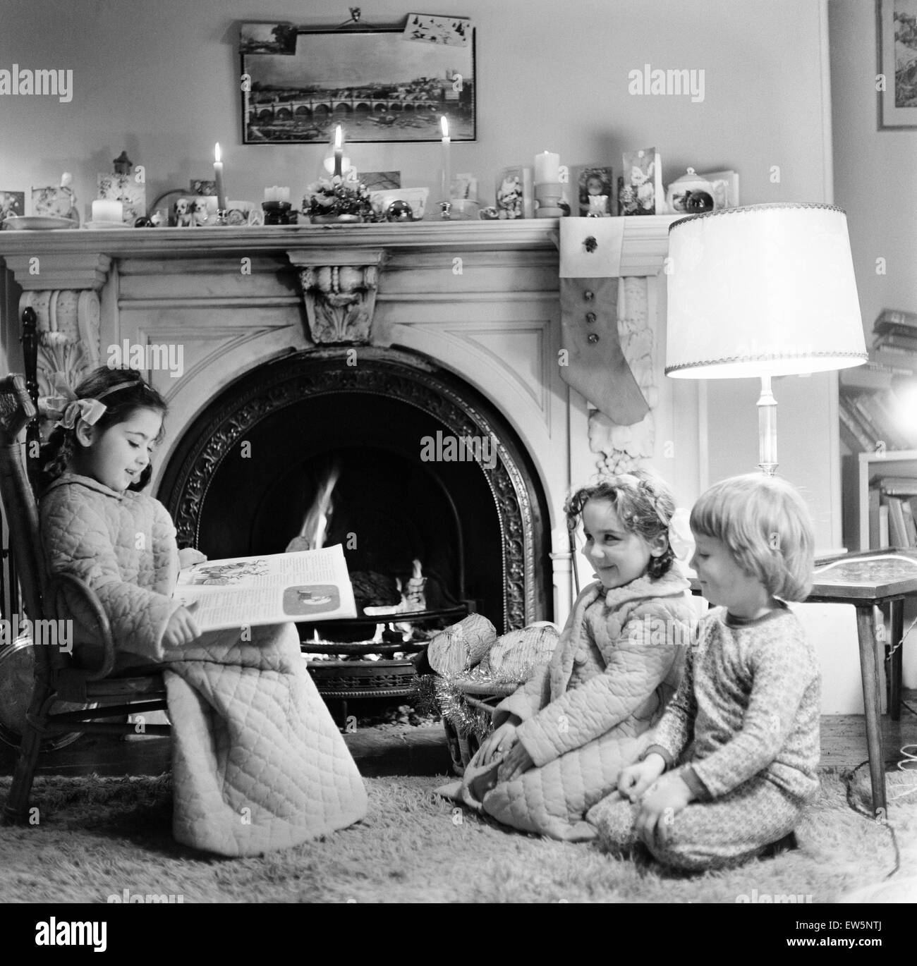 Christmas Eve, Children reading bedtime stories as they wait for ...