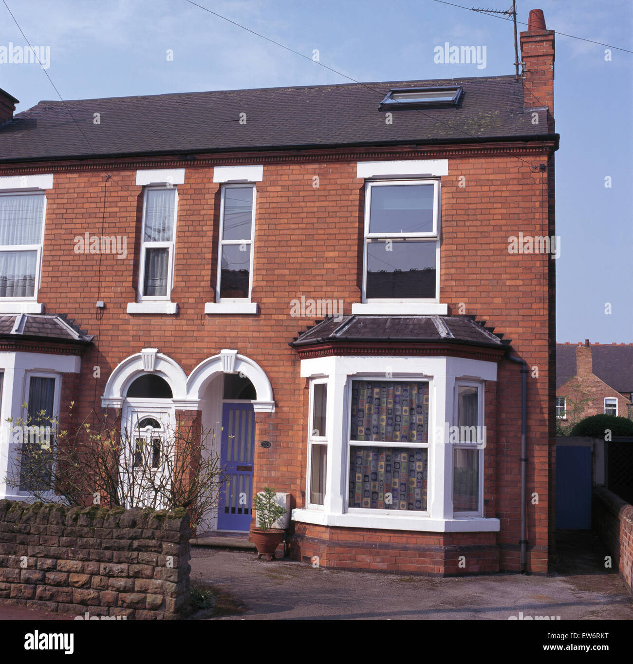 Exterior of a small semi detached victorian house stock Victorian house front