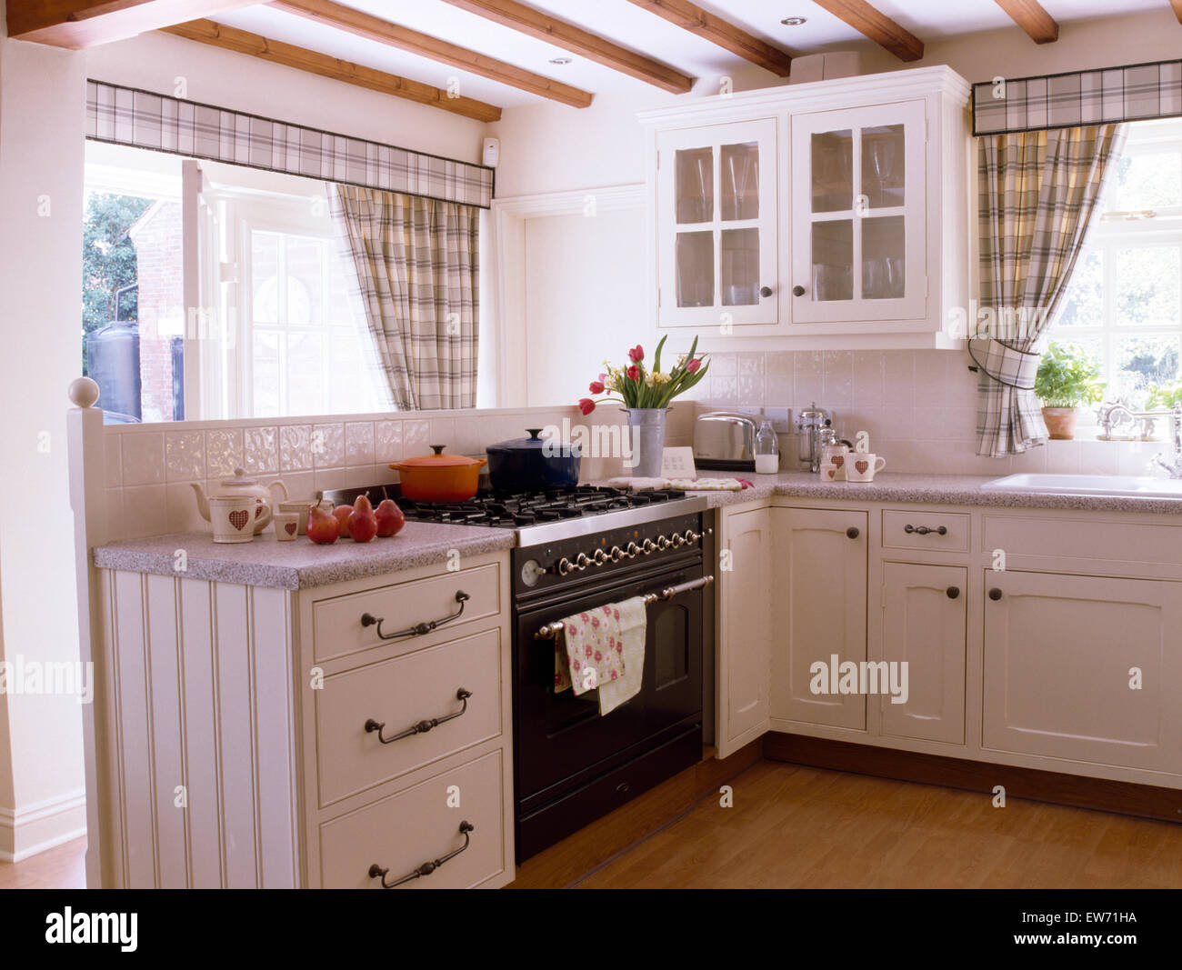 Black and white checked curtains - Black Range Oven In White Cottage Kitchen With Gray Checked Curtains On The Windows