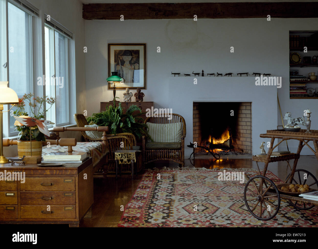 Captivating Kelim Rug And Old Pine Chest In Country Living Room With Lighted Fire In  The Fireplace