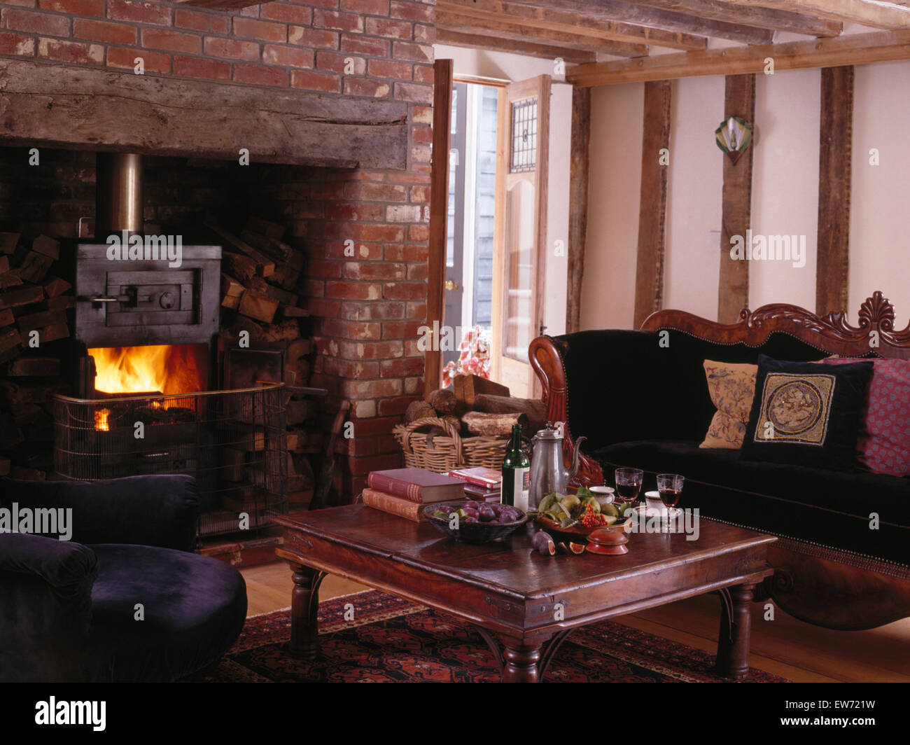 wood burning stove in inglenook fireplace in very traditional