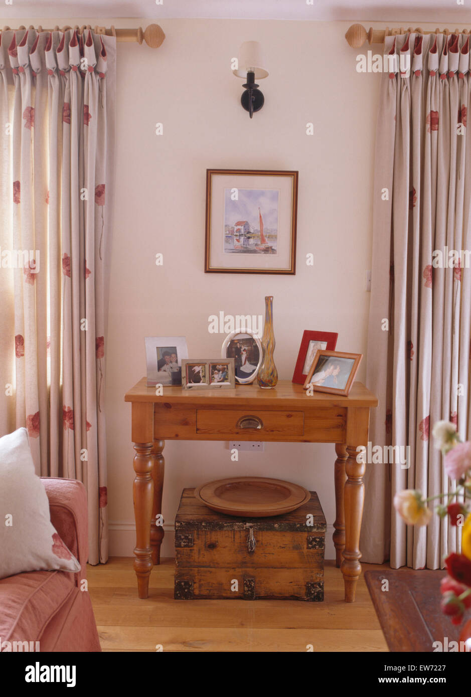 Red patterned curtains living room - Old Wooden Box Below Small Pine Table Between Windows With Red Patterned White Curtains In Country Living Room