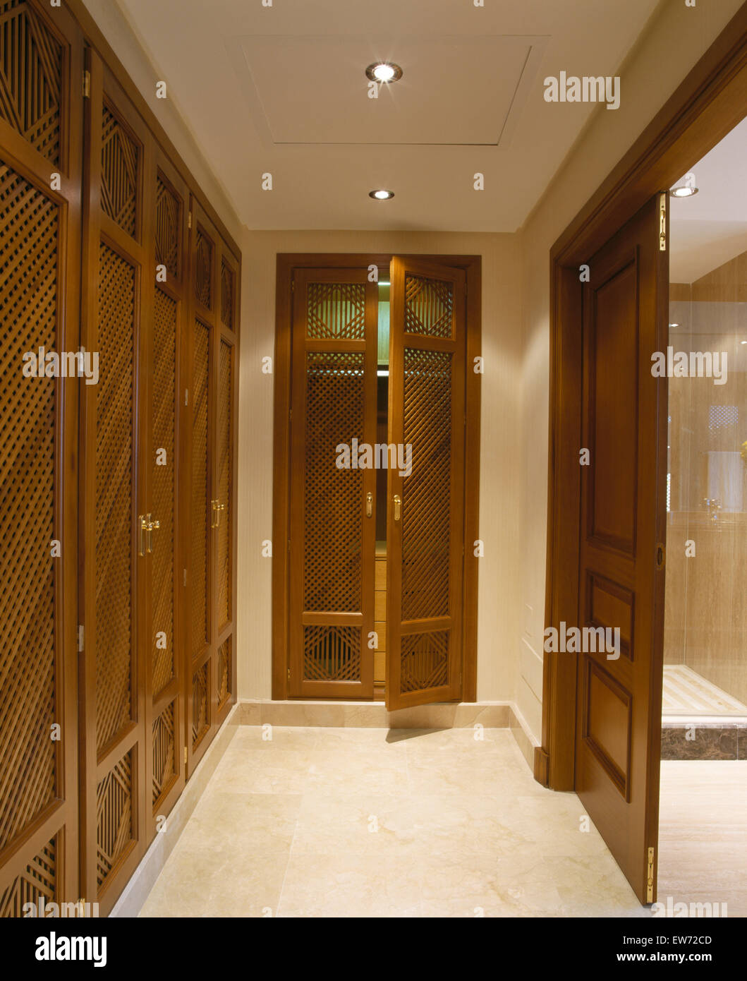 Fretwork Doors On Fitted Wardrobes In Modern Dressing Room