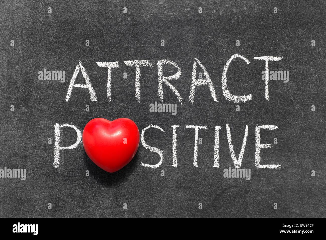 Attract positive phrase handwritten on blackboard with heart attract positive phrase handwritten on blackboard with heart symbol instead of o biocorpaavc
