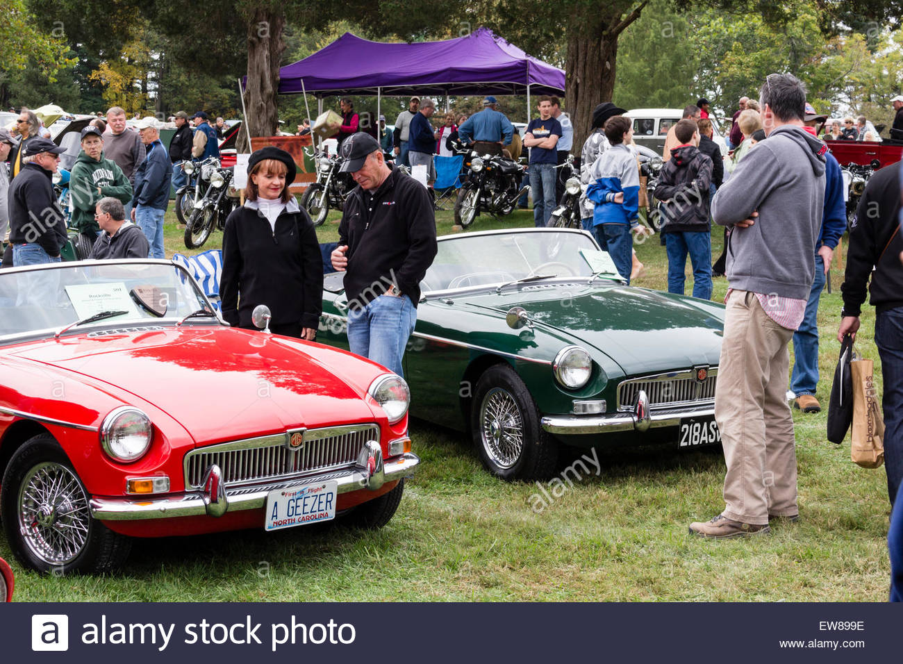 Visitors view a pair of 1964 MG B sports cars at the 2014 Rockville ...
