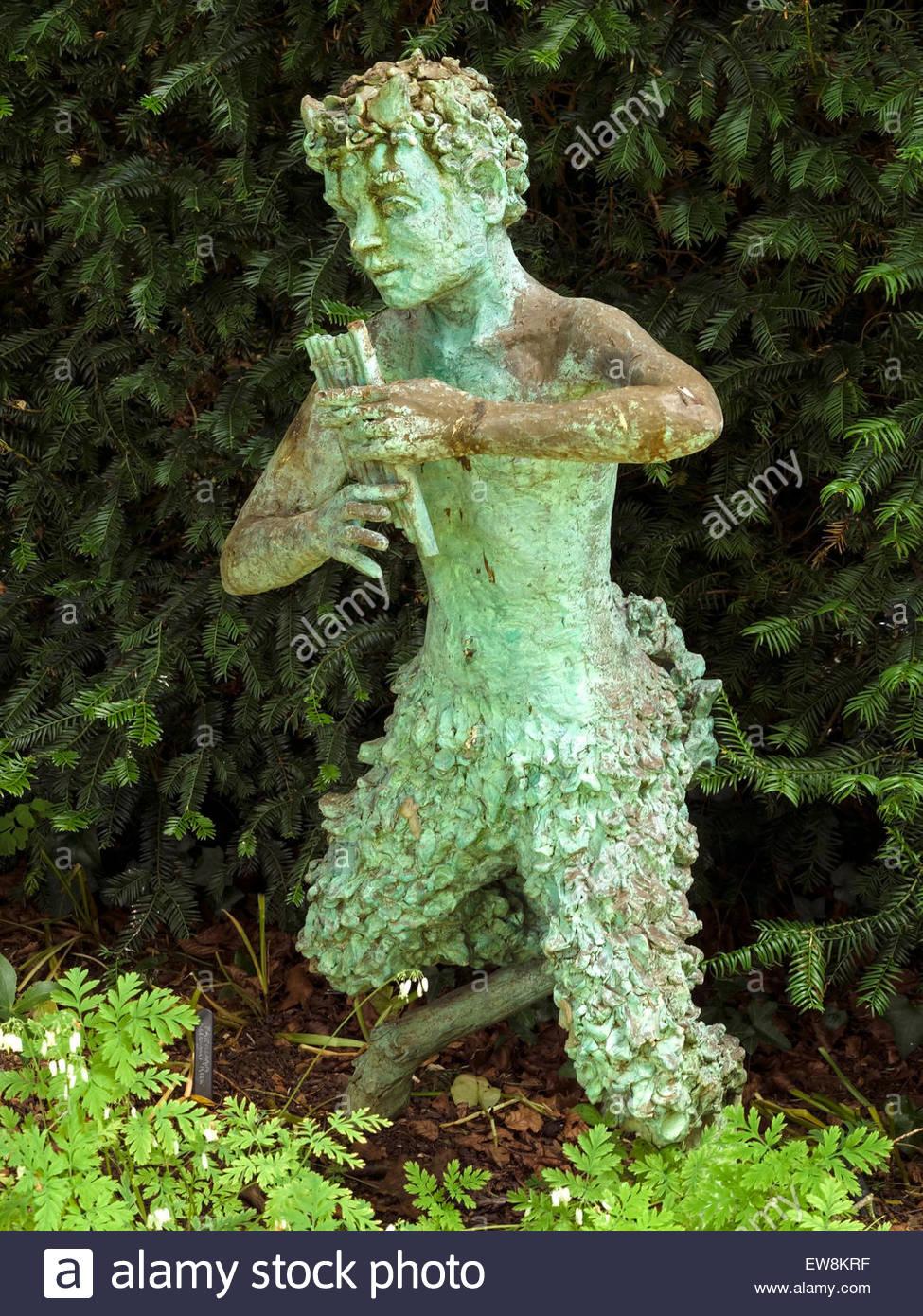 Stone Statue Of Greek God Pan Coton Manor Gardens Coton
