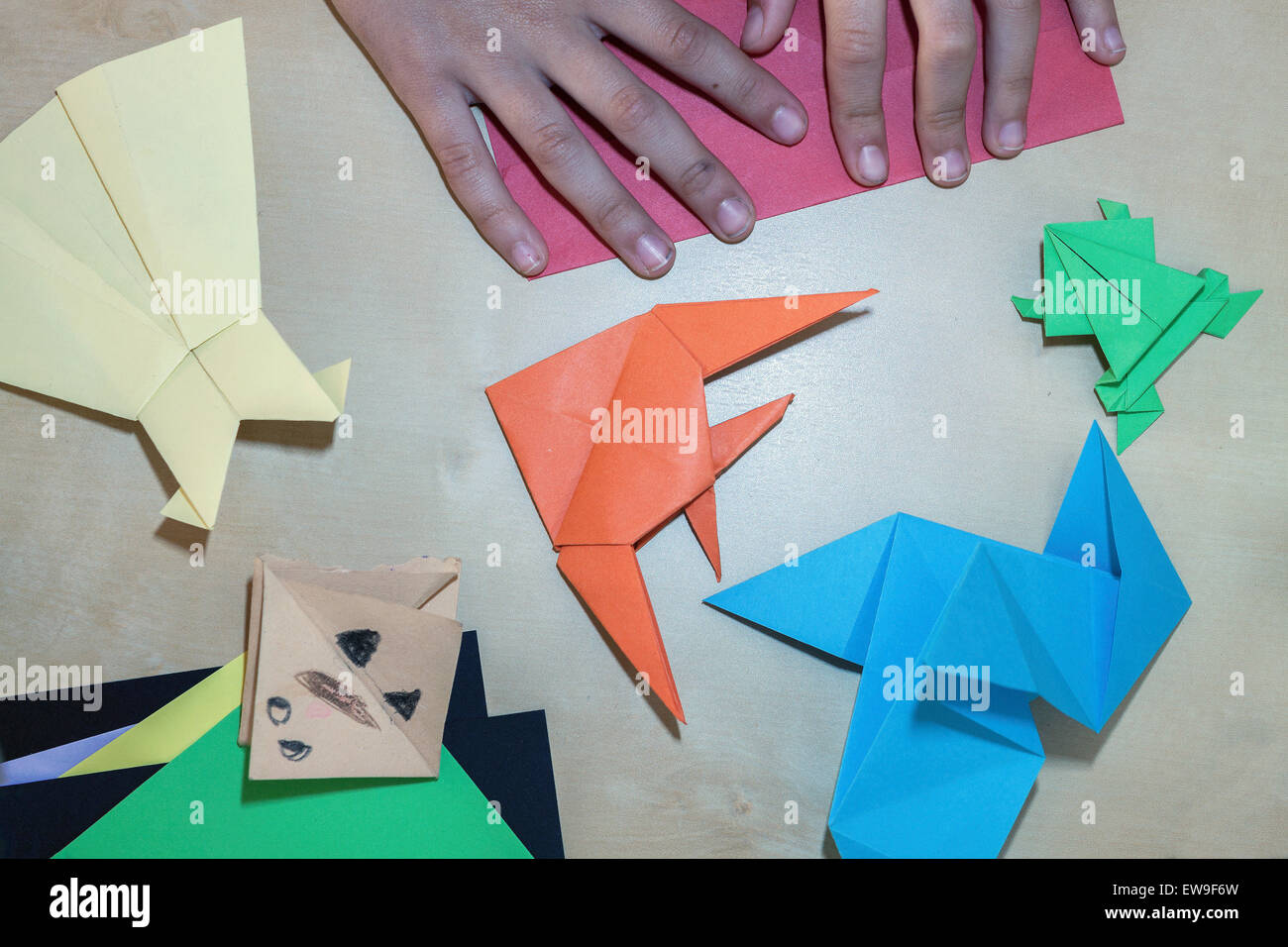 Little girl creating different origami objects in diffrent colours little girl creating different origami objects in diffrent colours jeuxipadfo Choice Image
