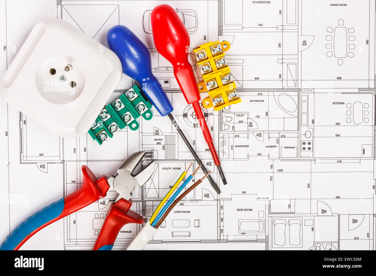 electrical equipment and tools on house plans stock photo