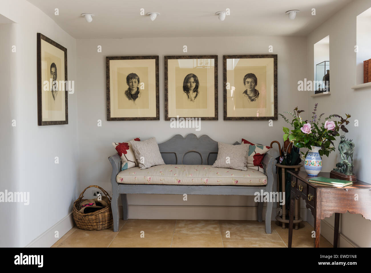 Wooden bench in entrance hall with child portraits and console wooden bench in entrance hall with child portraits and console table geotapseo Image collections
