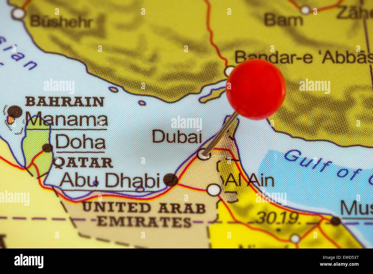Closeup Of A Red Pushpin On A Map Of Dubai United Arab Emirates – Map of Dubai United Arab Emirates