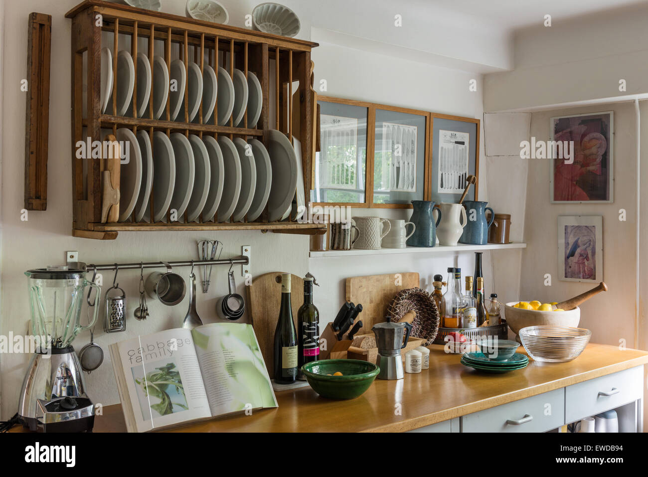 Rustic Style Kitchen With Wooden Plate Rack Assorted Jugs And
