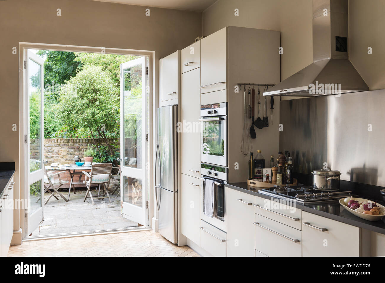 Garden To Kitchen French Windows Open Onto Garden From Kitchen Area With Stainless