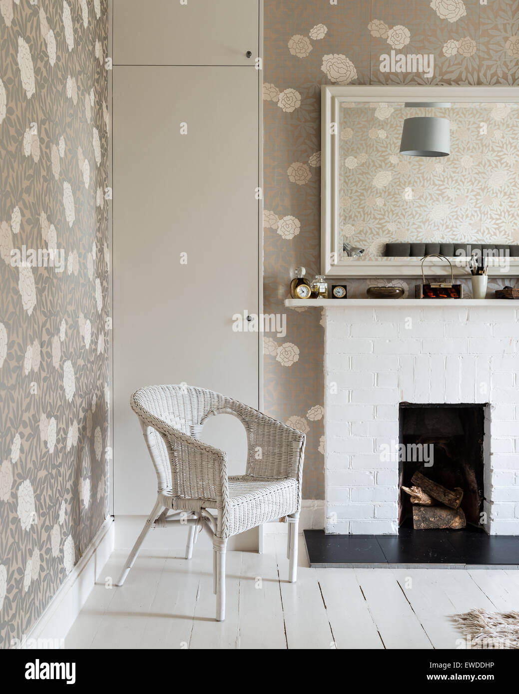 Stock Photo   White Cane Chair In Bedroom With Metallic Floral Print  Wallpaper By Osbourne U0026 Little And Brick Fireplace