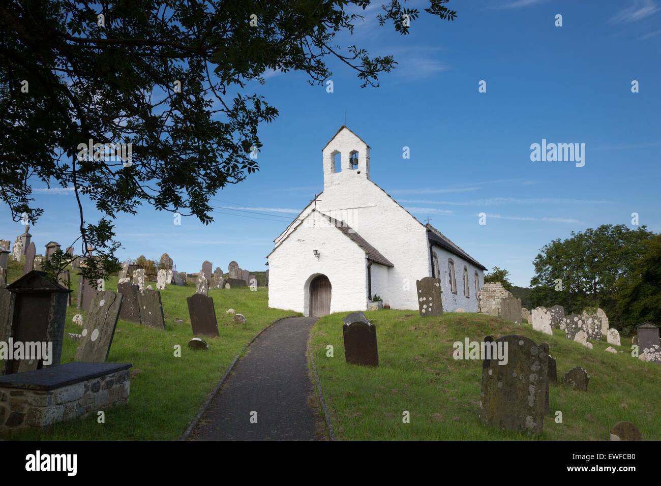 The ancient whitewashed church at Penbryn, on the mid