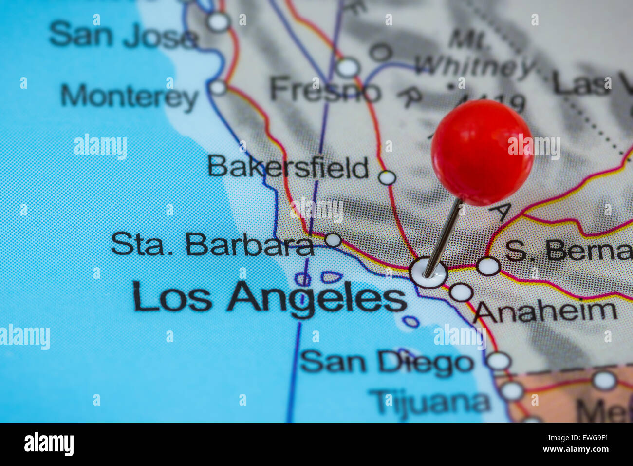close up of a red pushpin on a map of los angeles usa