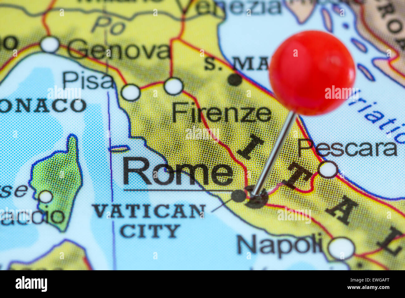 Close Up Of A Red Pushpin On A Map Of Rome Italy Stock Photo