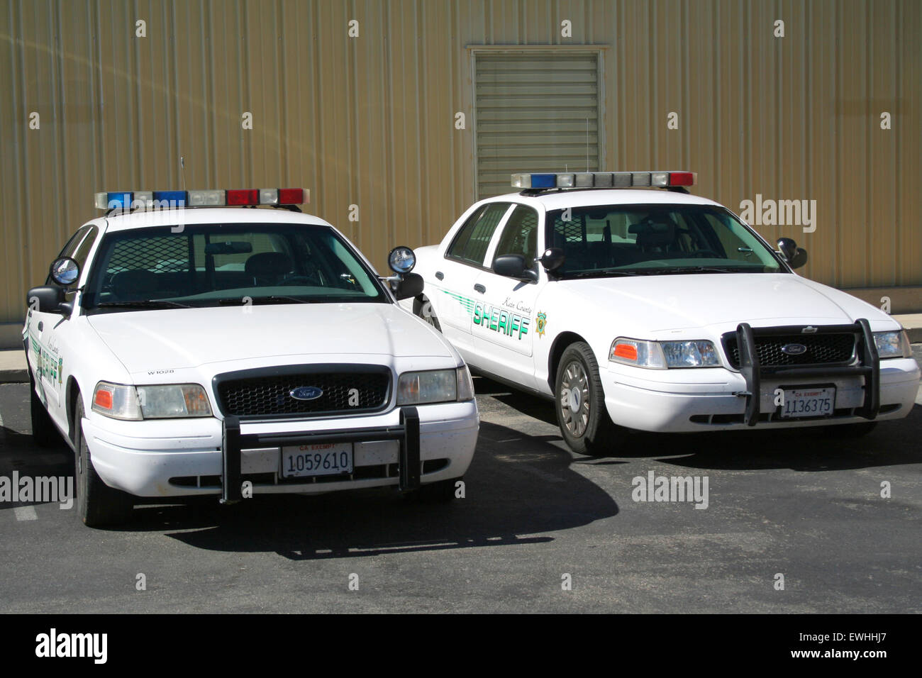 Two ford crown victoria police interceptor cars from the kern county sheriff stock image