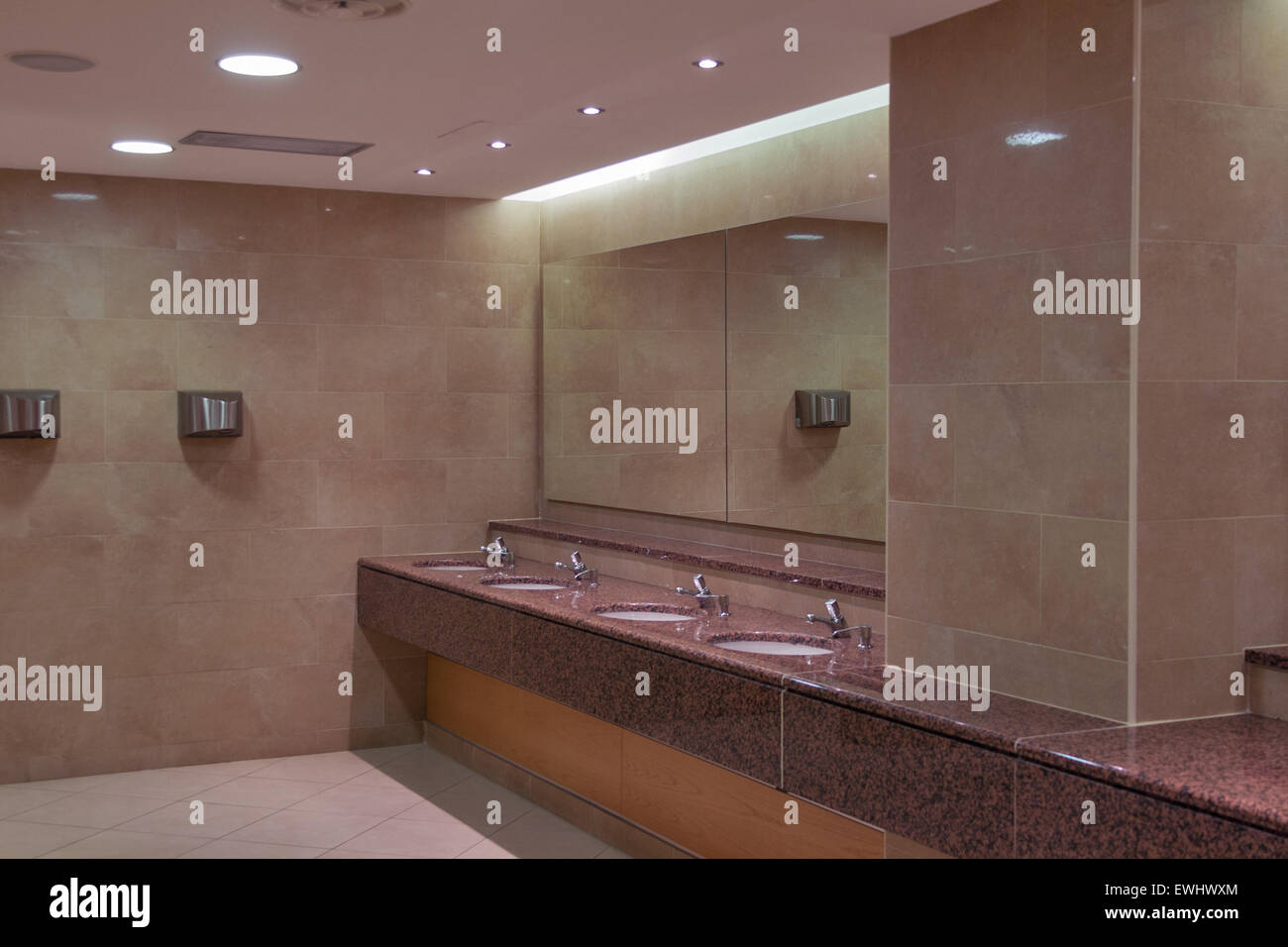 Sinks In A Public Toilet With Mirror And Hand Dryers