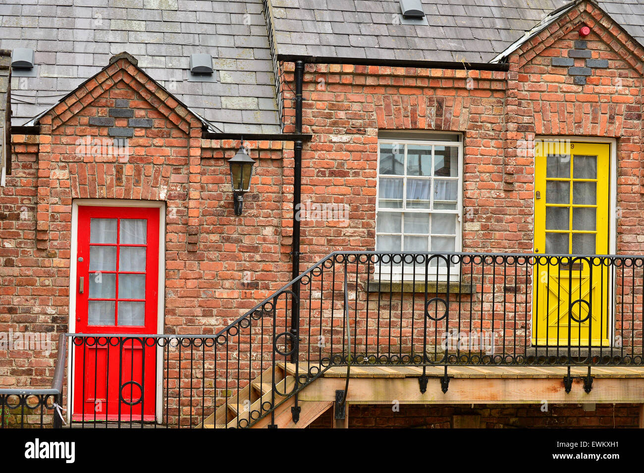 Red brick exterior and colourful doors of apartments in the Craft ...