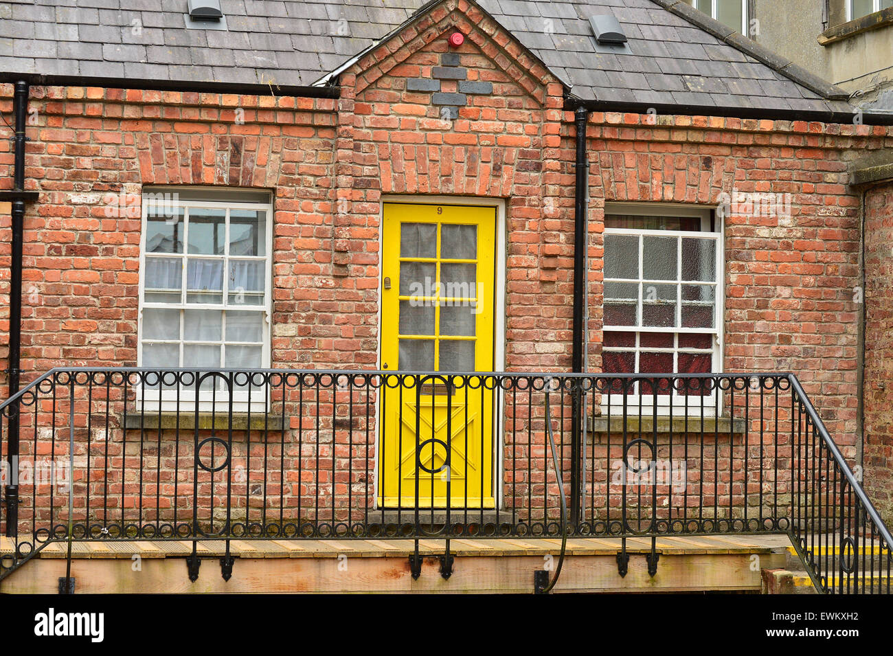 Red brick exterior and colourful doors of apartments in the Craft Village Londonderry (Derry) Northern Ireland & Red brick exterior and colourful doors of apartments in the Craft ...