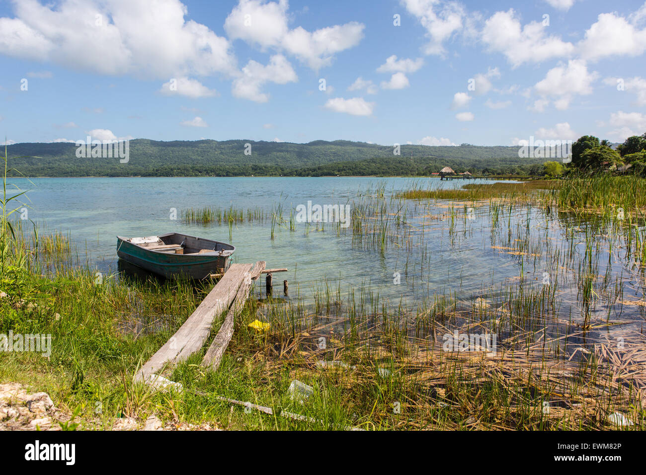 A Boat Rests Quietly On Lago De Peten Itza Guatemala Located On - Where is guatemala located