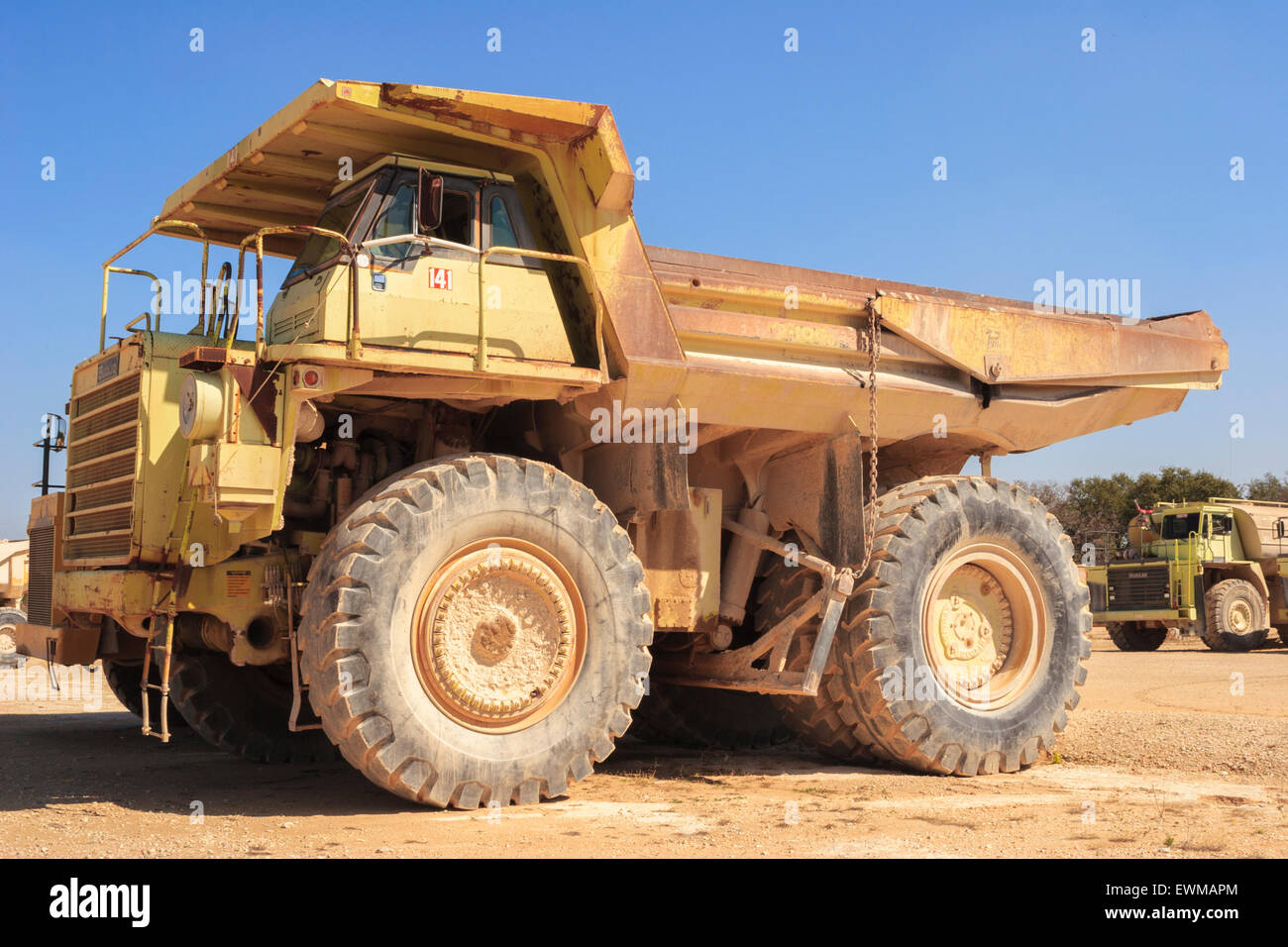 Large yellow euclid dump truck used to haul material in rock quarry