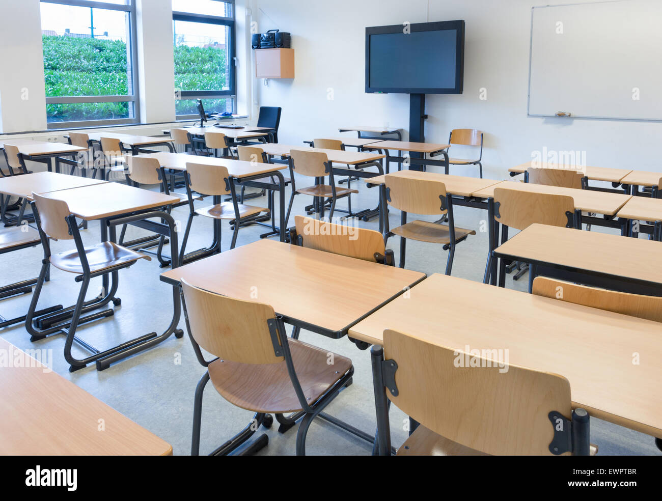Empty classroom with tables and chairs in school building ...
