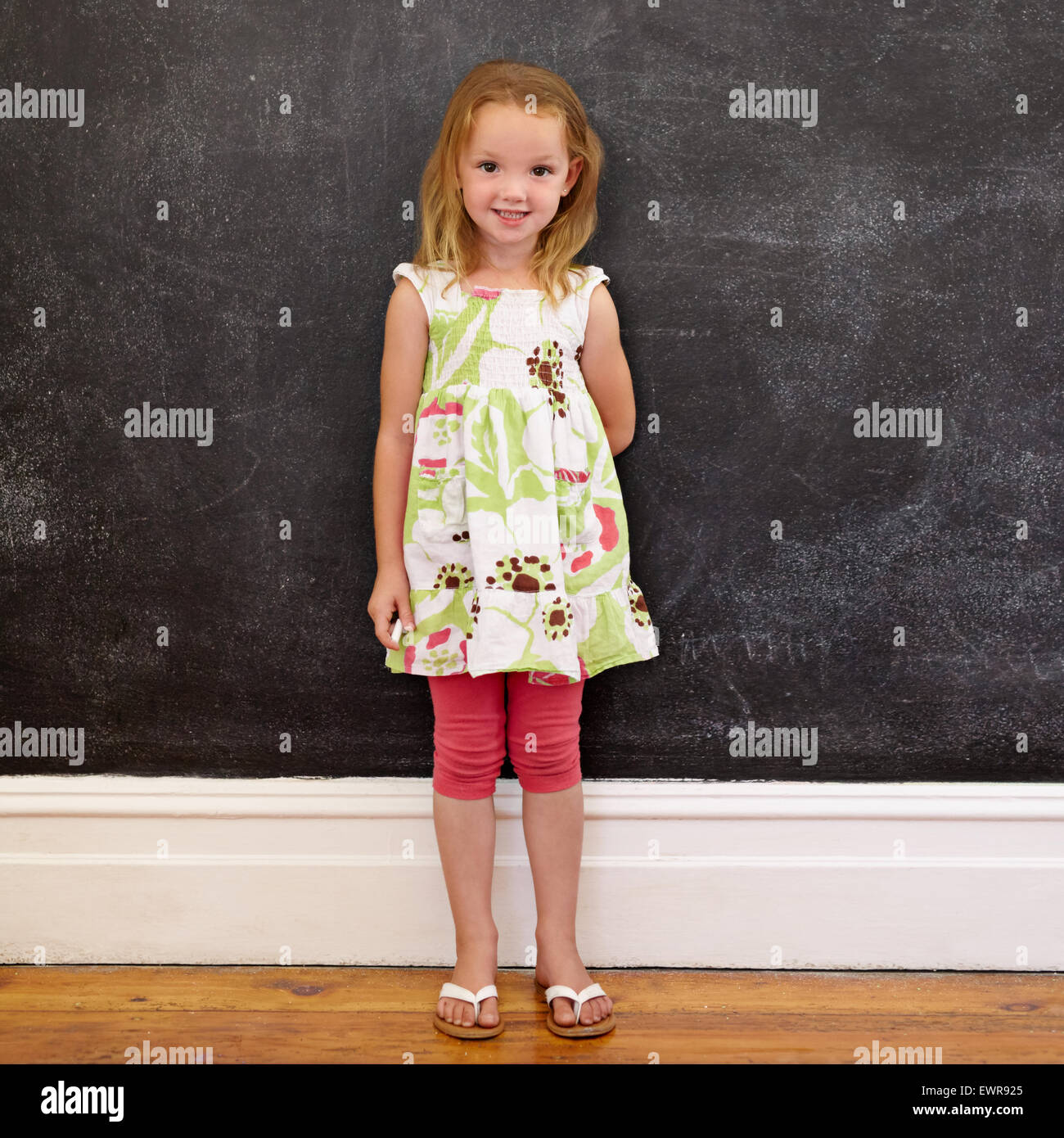 Beautiful Little Girl Bedrooms: Full Length Shot Of Beautiful Little Girl Standing Against