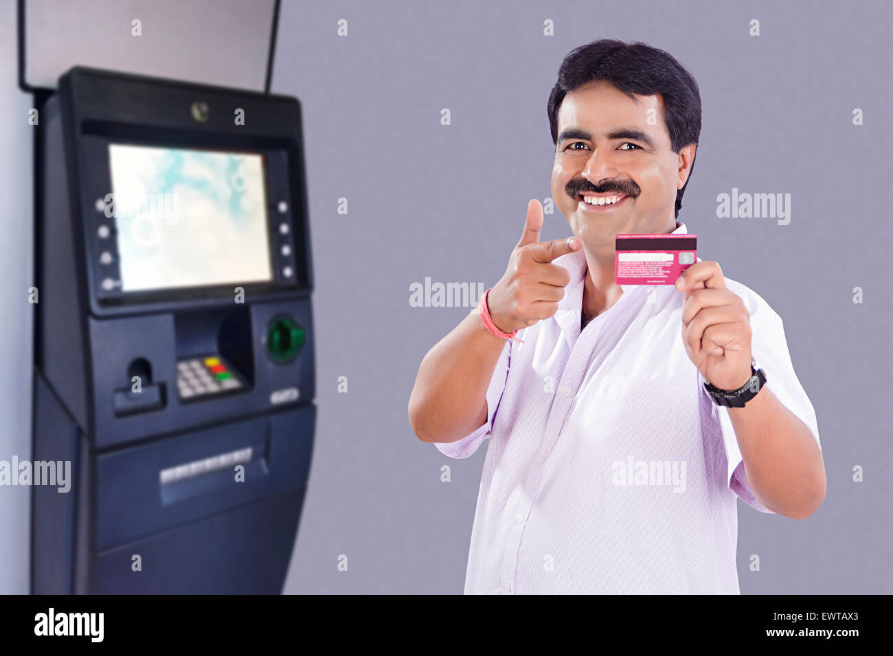 1 indian man atm machinery credit card showing stock photo 1 indian man atm machinery credit card showing reheart Choice Image