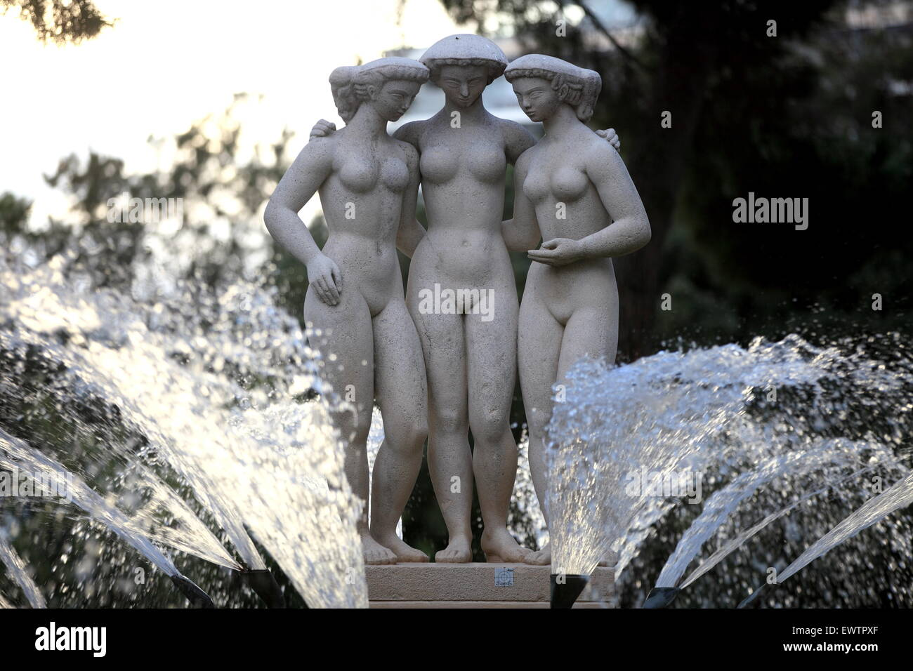 Naked women in fountain are