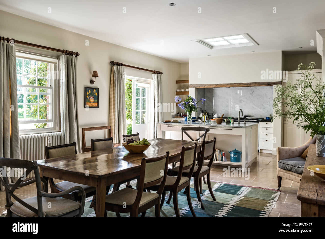 antique dining table with chairs in open plan kitchen dining room