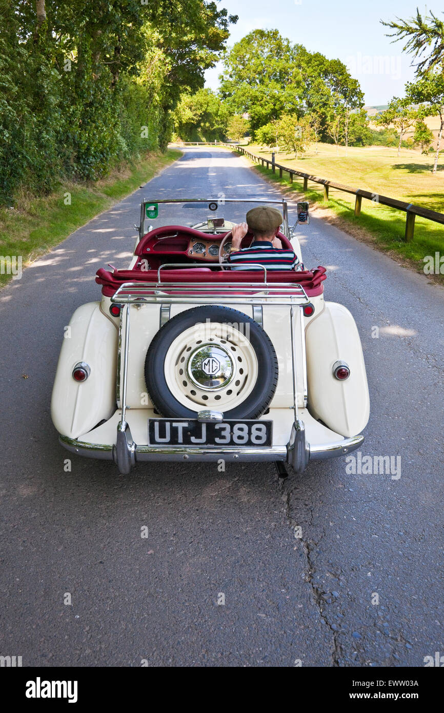 Mg tf 1500 stock photos mg tf 1500 stock images alamy rear view of white mg tf 1500 classic car being driven down a country lane vanachro Images