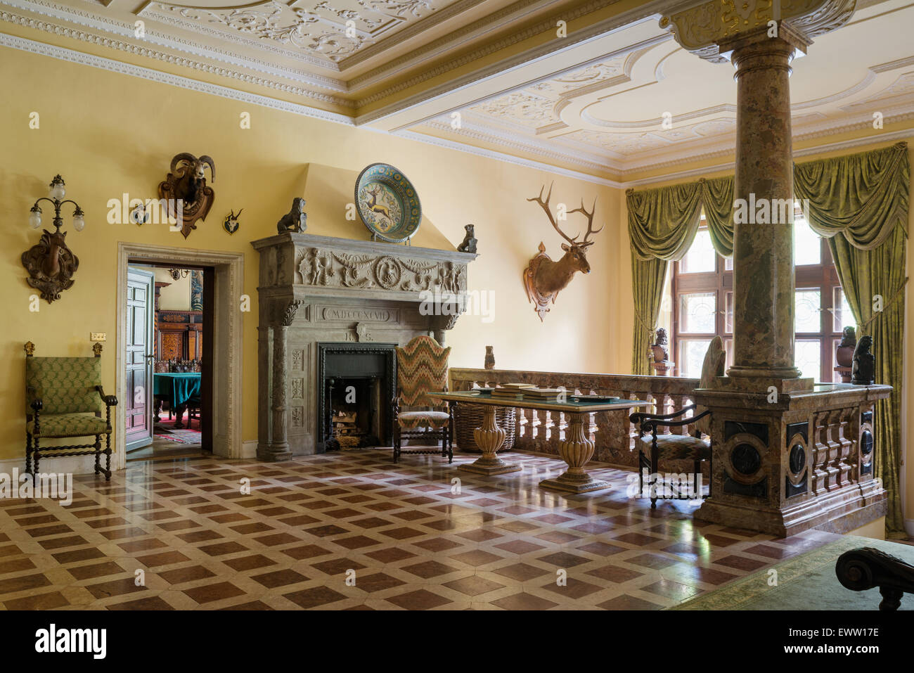 Large Stone Fireplace large stone fireplace in castle hallway with marble flooring
