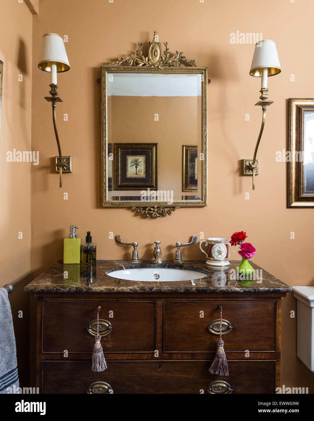 Marble topped antique vanity unit in cloakroom with walls painted in Indian  Summer by Flamant Paris. - Marble Topped Antique Vanity Unit In Cloakroom With Walls Painted