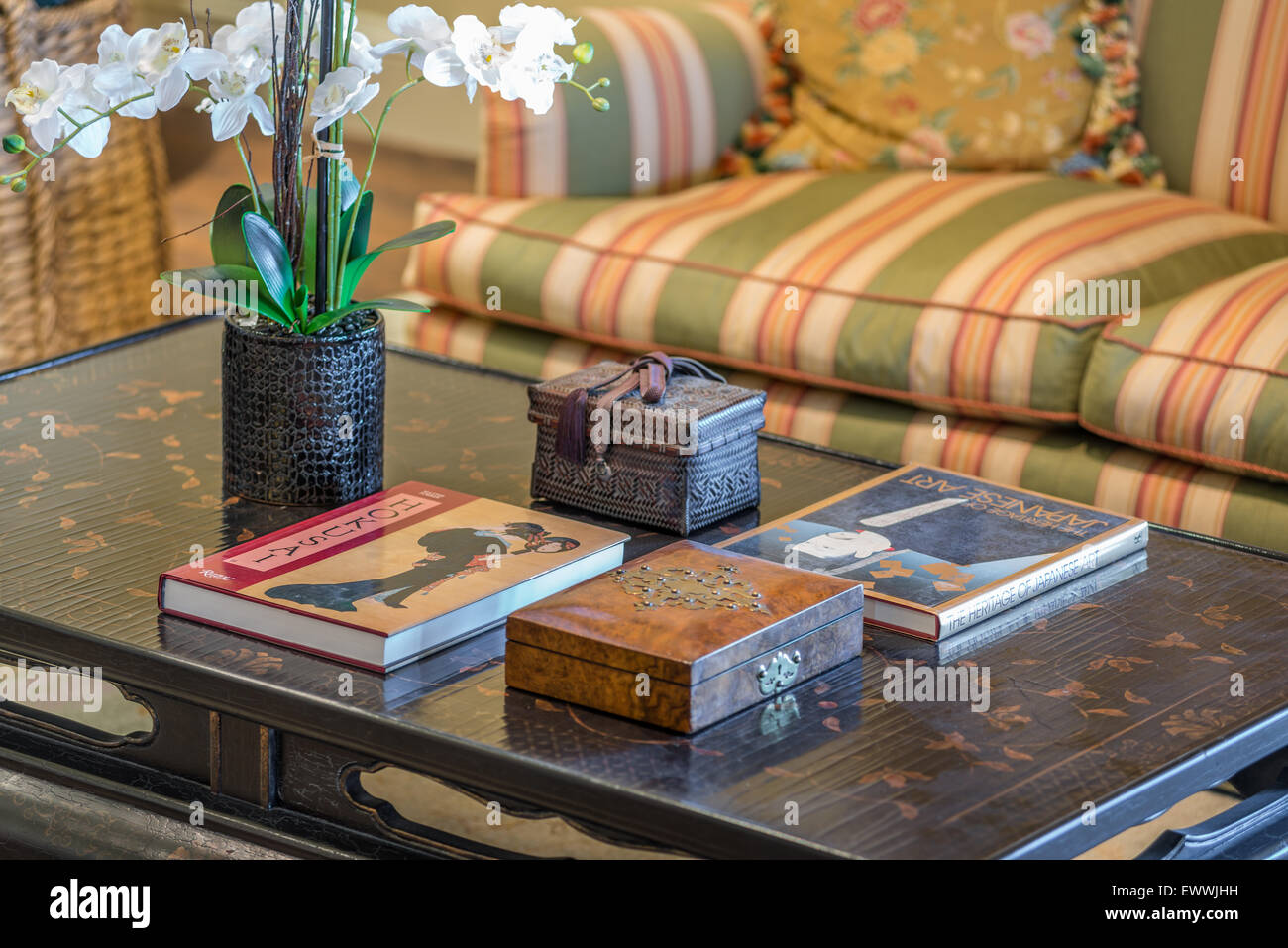 coffee table books orchid sofa home staging props stock photo