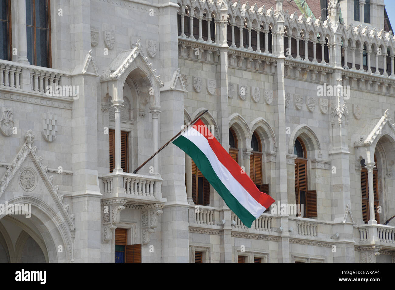 hungarian flag on the facade of parliament palace budapest hungary
