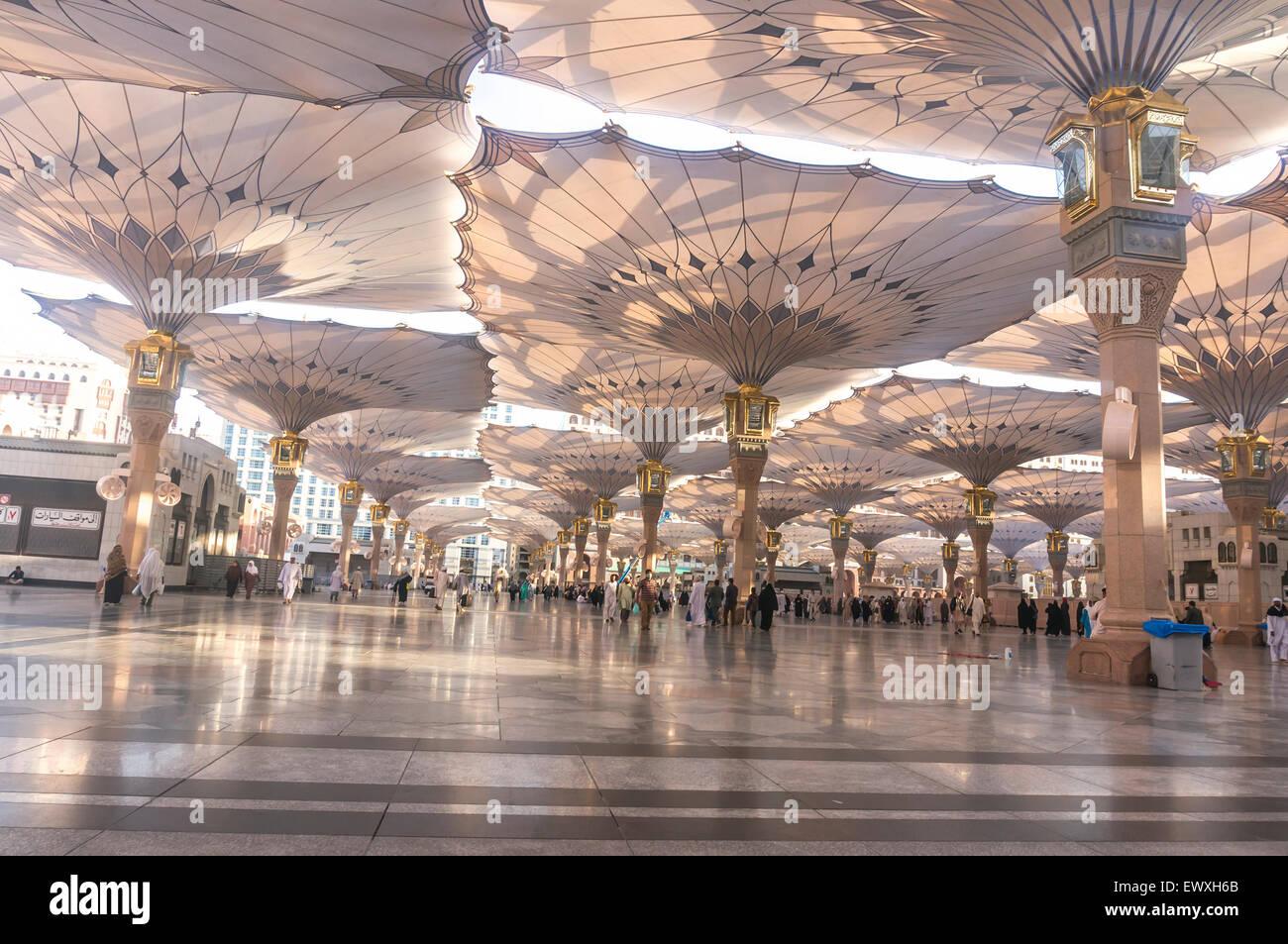 MEDINA, SAUDI ARABIA - MARCH 06, 2015 : Pilgrims walk ...